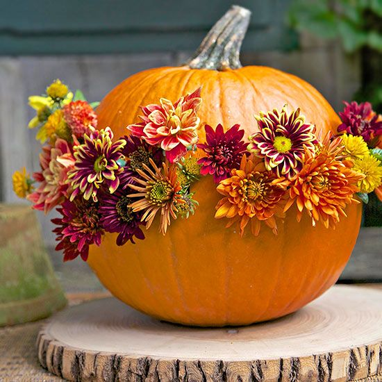 This can be a pretty centerpiece, and can work with any size pumpkin. Or use mini pumpkins decorated with a few mums and spread out along the length of a table, and this idea works as a wonderful table runner.: