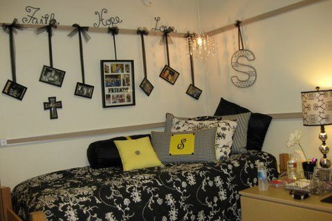 Dorm room....since no holes can be hung in the walls these gals hung ribbon from frames and then tacked them to the corkboard,,,clever and pretty!