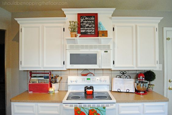 Microwaves shelves and builder grade on pinterest for Kitchen cabinet height from floor