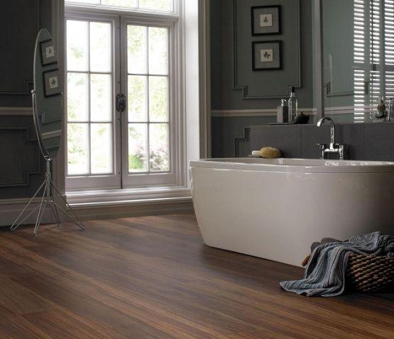 Laminate Flooring In Bathroom With Dark Gray Wall Paint Flooring Ideas Floor Design Trends Vinyl Flooring Waterproof Laminate Flooring Vinyl Plank Flooring