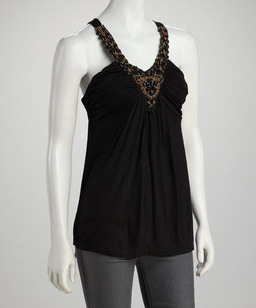 p style=margin-bottom:0px;spanspan class=searchwordb1e129Gleaming beads abound on the front of this contemporary-cool tank. Styled for success on an elegant evening, this top combines eye-catching embellishment with a ruched bodice./span/bottom:0px;Measurements (size S): 29span class=searchwordb2b4c8 long from high point of shoulder to hem/span/lili stbottom:0px;spanspan class=searchword7cb98b95% rayon / 5% spandex/span/span/lili style=margin-bottom:0px;span class=searchword9456c5Hand was