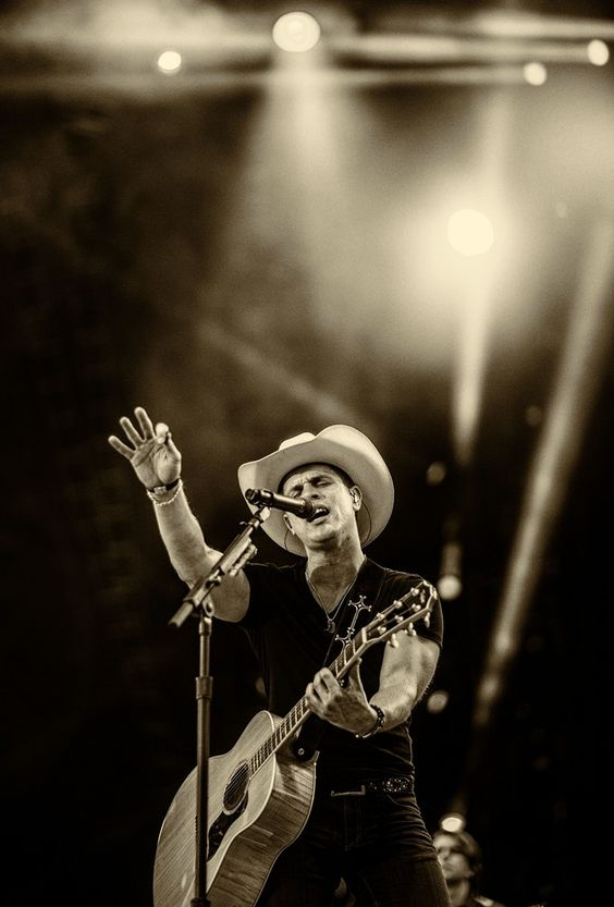 This image has been altered digitally) Singer/songwriter Dustin Lynch performs during the Route 91 Harvest country music festival at the MGM Resorts Village on October 5, 2014.