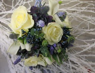 We've included Crystal Blush Calla Lilies, White Tulips, Avalanche Roses, Blue Hydrangeas, Muscari and Viburnum Berries