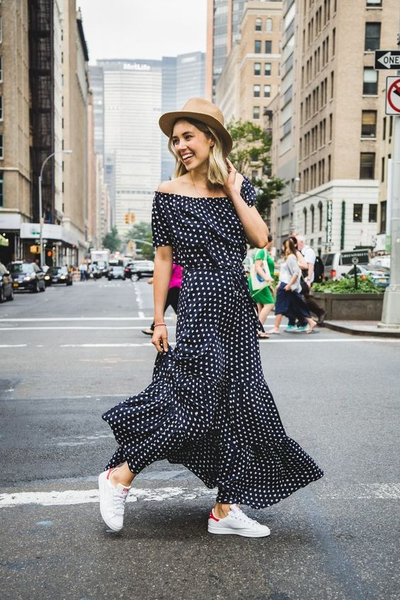 A brand new trend that women across the world are adopting: sneakers + dress = feminine and comfortable combo.: