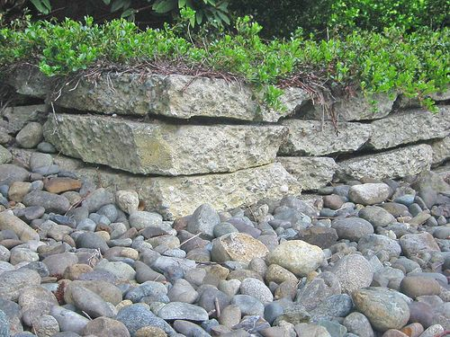 How to use pieces of broken concrete to build a wall via wikihow com landscaping
