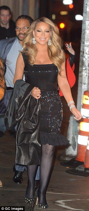 Glamourpuss: Mariah showed off perfectly coiffed locks and glittering earrings...
