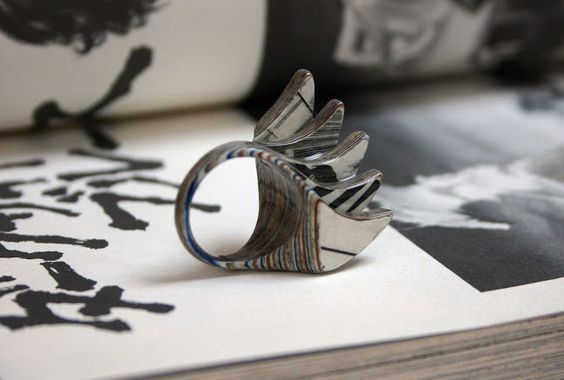 Jewelry maker Jeremy May designs wearable pieces from the layered pages of vintage books