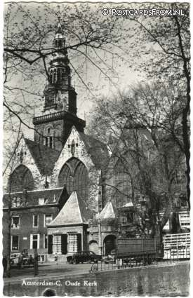 1964. The Oude Kerk in Amsterdam. The 800-year-old Oude Kerk is Amsterdam's oldest building and oldest parish church, founded ca. 1213 and consecrated in 1306 by the bishop of Utrecht with Saint Nicolas as its patron saint. The church is located at the Oudekerksplein. The square is wedged between the Warmoesstraat and Oudezijds Voorburgwal canal. #amsterdam #1964 #Oudekerk