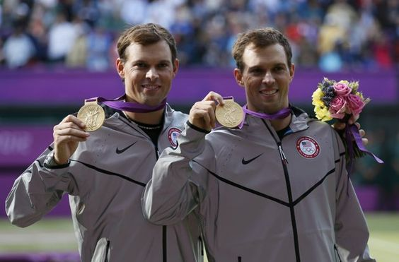 Brothers Bob Bryan and Mike Bryan pose with their gold medals during the presentation ceremony after they defeated France's Jo-Wilfried Tsonga and Michael Llodra in the men's doubles tennis final match.
