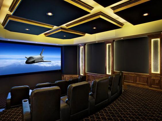 luminous home theater dynamic design elements and led lighting add drama to this 3d ready. Black Bedroom Furniture Sets. Home Design Ideas