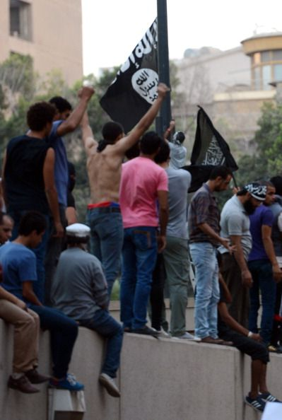 Egyptian Protesters Climb Walls Of U.S. Embassy, American Flags Taken Down And Replaced With Black Al-Qaeda Flags…>> Keep in mind these are the same protesters Obama backed during the Arab Spring uprising against Mubarak.