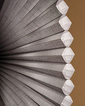 Hunter Douglas Grey Duette Architella cellular shade close up of their 'cell within a cell' design. Great insulation. See more examples of window covering ideas on our site.