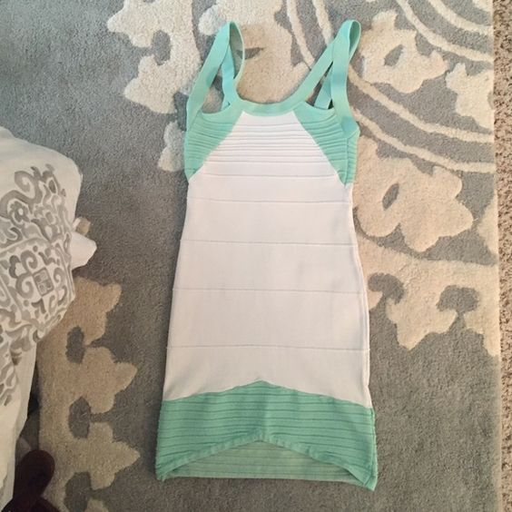Cute turquoise and white dress! This bodycon turquoise and white dress with cutouts is adorable and super flattering! Perfect for sorority formals/date parties/girls night out/etc.! WOW couture Dresses Mini