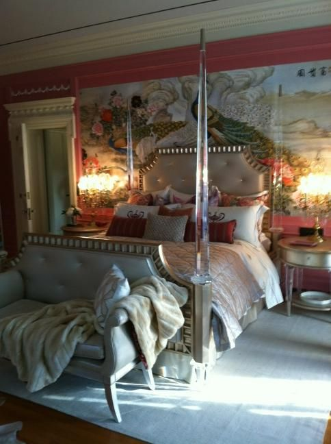 Baroque inspired mural behind the bed with Neo-clasical door trim. The two styles are anachronistic.