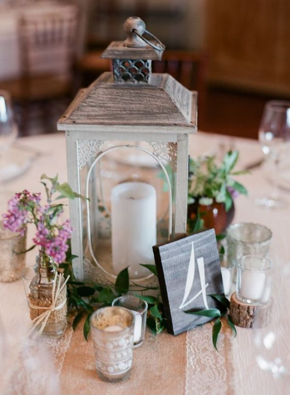 rustic wedding reception lantern and table number wedding centerpiece / http://www.deerpearlflowers.com/rustic-lantern-wedding-decor-ideas/