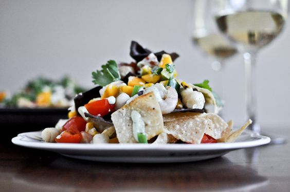 Summertime Seafood Nachos with Grilled Corn + Avocado Cream.
