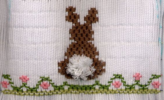 """Brown smocked bunny is """"JG Rabbit"""" smocking design from Layette pattern by Collars, Etc. Pattern Company.  Tail is turkey work."""