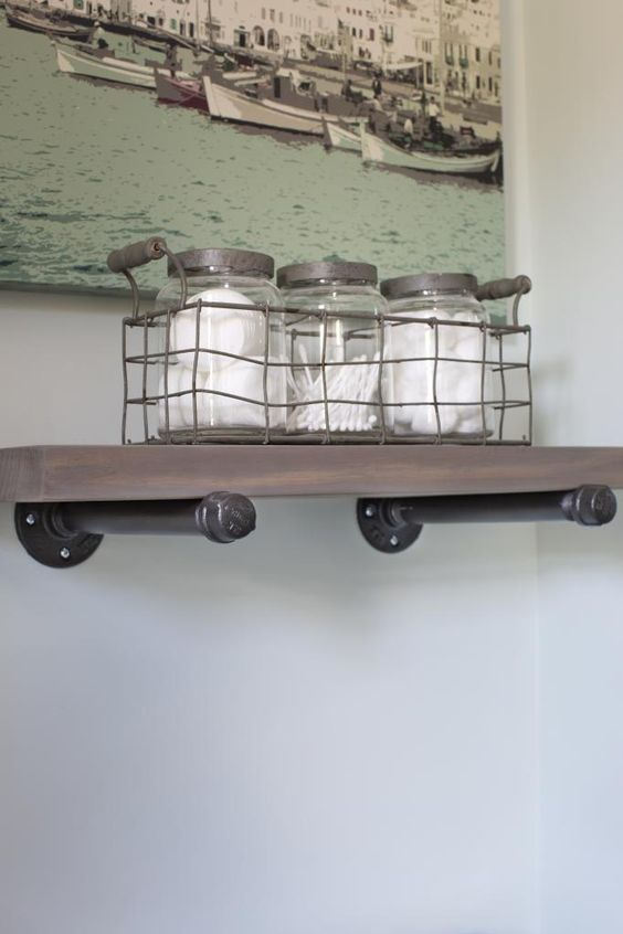 shelf - .I DIYed this pipe shelf for over the toilet and it has to be one of my easiest and fastest projects to date.  It was done in less than an hour!  I love that I got to customize the size and now it is the perfect spot for those bathroom 'extras' and that darling glass jars collection.  I think it really anchors the artwork too!