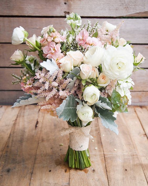 Natural organic bouquet with ranunculuses, roses, astilbes, double stocks and dusty millers