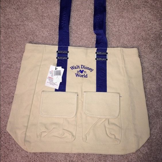Single Walt Disney World Tote Bag In perfect condition. New with tags. Disney World canvas tote with blue handles. Bags Totes
