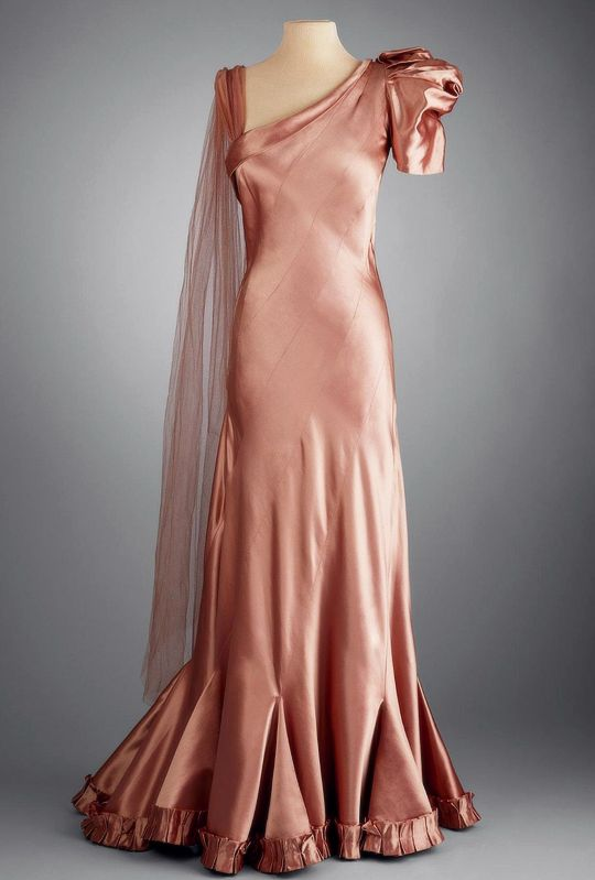 Piguet dress in copper satin c1933-37 This dress is made using the bias grain of the fabric. Learn how on The Bias Drape, VFC249A