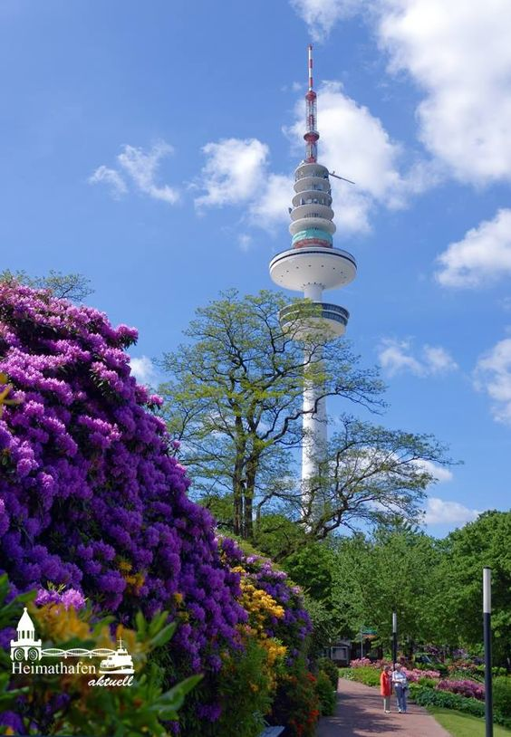 Heinrich-Hertz-Turm in Hamburg, Germany - photo by Heimathafen Aktuell - Inga Lewandowski (page 10); The 916 feet tall tower is near the Park Planten un Blomen. It is a radio/TV broadcast tower named for German physicist Heinrich Hertz. The building was completed in 1968. There are 8 concentric platforms. At 420' up, the lowest platform had a 2-story observation floor and restaurant (with high speed elevators) that have since been closed due to asbestos. At 492' is the operations platform.