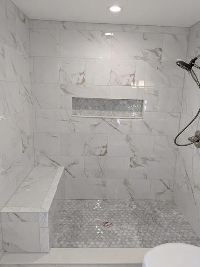 Msi Carrara 12 In X 24 In Polished Porcelain Floor And Wall Tile 16 Sq Ft Case Nhdcarr122 Shower Remodel Master Bathroom Shower Bathroom Remodel Shower