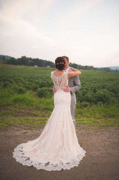 Lace wedding dress with amazing detailed back {Brit Perkins Photography}