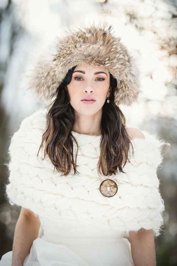 Winter wedding - Bride with chunky cable knit wrap -  Photography: CarlaTenEyck.com - More wedding inspiration on SMP: http://www.stylemepretty.com/2014/06/05/winter-cabin-wedding-shoot/: