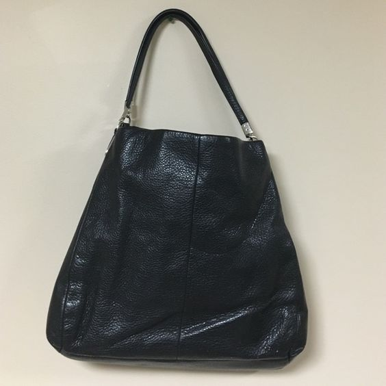 Vintage Black Coach Bag ! Vintage Black Coach Bag ! Two sides as well as a hidden area in the middle compartment that zippers close. Comes with original cloth bag. Coach Bags