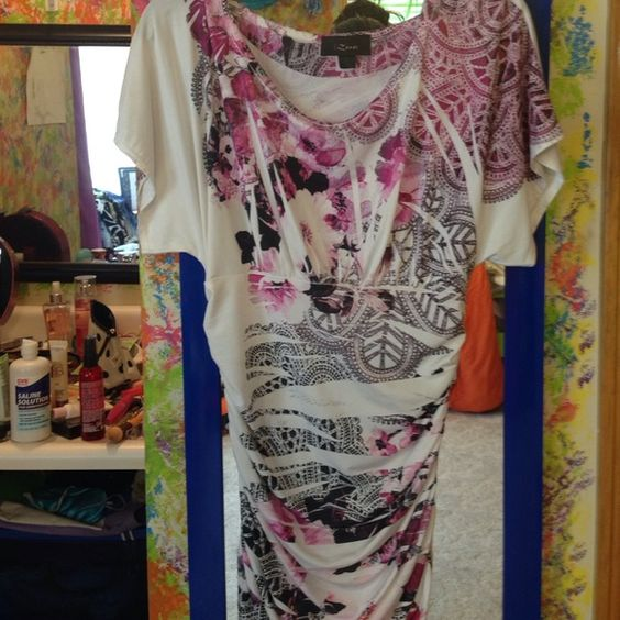 White, pink, and black floral blouse silky white blouse with black and pink/purple floral designs on it. Top is loose, the sides are stretchy. Worn this several times but it's in perfect condition Iz Byer Tops Blouses