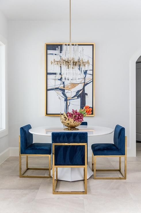 Luxe Dining Space Boasts Contemporary Furnishings A Set Of Gold