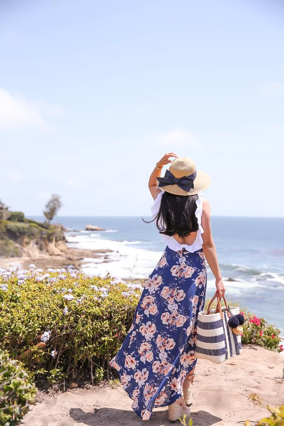 floral maxi skirt, ruffle one piece swimsuit, bow hat, striped straw tote, summer outfit, beach cover up