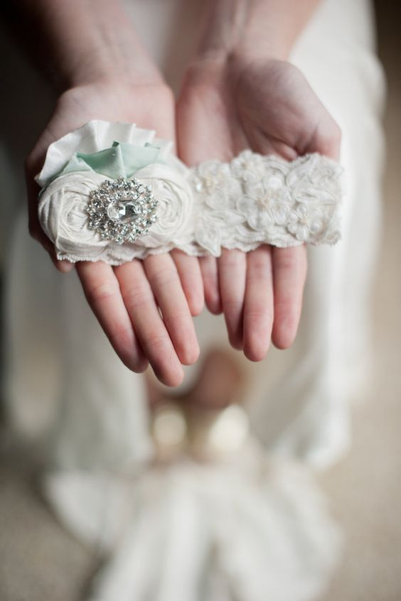 Teal flower garter by Emily Riggs.