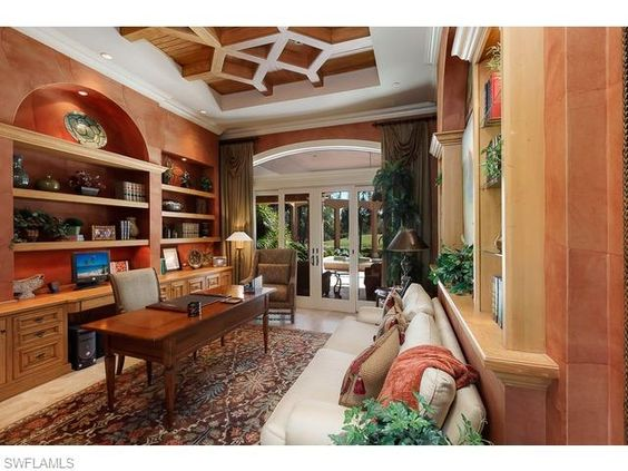 15306 Corsini Ln, Naples, Fl 34110   Home office study with Tuscan red walls and wood ceiling details in the Il Corsini neighborhood of Mediterra   Naples, Florida