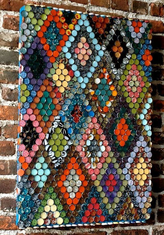 Bottle Cap Art - I love seeing a good recycled art project - this one is just stunning.  This would be a fabulous collaborative makerspace project for students to work on.