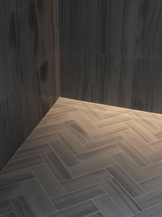Zebra Gray is a limestone featuring dramatic linear striations. Available through Stone Source. Shown here in a chevron pattern.