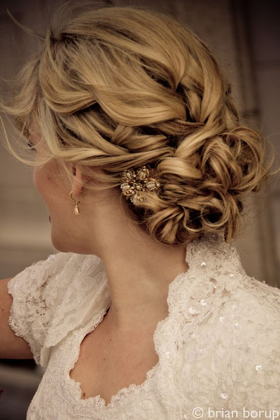 Twisted low off-centered bun with antique clip.  Looks romantic and unfussy.