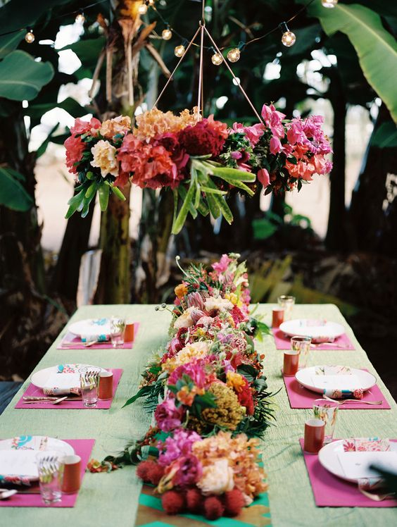 Tropical Wedding Centerpiecs and decorations | Colorful flowers | pink and green | jonathancanlasphotography.com Read More: http://www.stylemepretty.com/destination-weddings/2014/05/12/colorful-banana-orchard-wedding-inspiration/