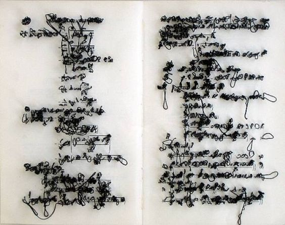 Integral by Jonathan Callan, 2002   Stitching words is interesting, cause it distorts the wording to a point where it is difficult to read. Also you then get the back of the image to, where it is even more distorted.