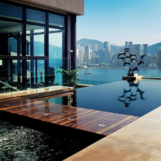 Presidential Suite - Harbourview Terrace by InterContinental Hong Kong http://flic.kr/p/83jMhb The black glass mosaic infinity swimming pool has two infinity edges: one facing the harbour and the other facing the living room. The water overflows onto a textured stonewall to create ambient noise thus providing a calming effect. Statues (with bronze finish) of birds adorn each side of the infinity pool-ready to take flight across the harbour.