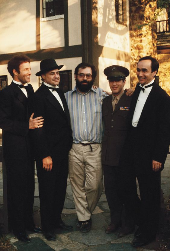 Portrait of Francis Ford Coppola flanked by James Caan, Marlon Brando, Al Pacino, and John Cazale. (The Godfather I):