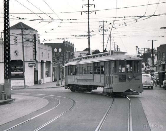 Los Angeles Transit Lines B Line streetcar no. 466 negotiates a left turn at Evergreen and Wabash in the City Terrace area of Los Angeles on an overcast day.
