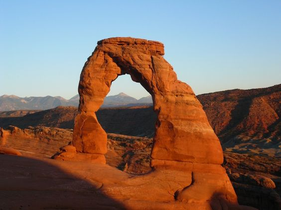 Delicate Arch is a 65-foot (20 m) tall freestanding natural arch located in Arches National Park near Moab, Utah.It is the most widely-recognized landmark in Arches National Park and is depicted on Utah license plates and on a postage stamp commemorating Utah's centennial anniversary of statehood in 1996. The Olympic torch relay for the 2002 Winter Olympics passed through the arch.Wikipedia