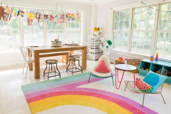Colorful Modern Playroom with Retro-Inspired Rug and #feltballgarlands