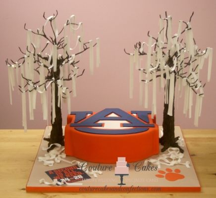 Is your groom looking for a unique way to integrate his favorite college football team into the reception?  Couture Cakes can create the prefect cake for you and your groom!  From Toomer's corner to the Auburn University emblem, this cake has it all! Click the image and learn more about Couture Cakes! Photo credit: CoutureCakesAndConfections.com