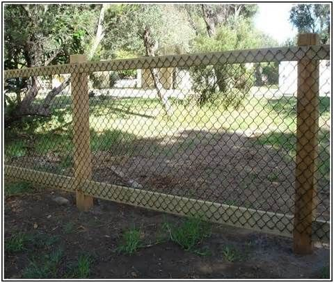 This fence is super easy because it's a wood frame that's covered over with some wire. You can buy this wire just about anywhere and then just use a staple gun to attach it to your frame and you're done.
