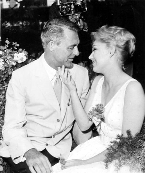 Cary Grant and Kim Novak at a party: