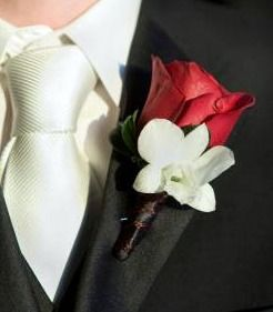 Another simple idea is just using a red rose and a stephanotis. The stem is wrapped with brown floral tape, making this a 'natural look' boutonniere.