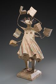 (Voracious Reader. Sculpture by Kathy Ross